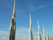 On the roof of the Milan / Milano Dome / Duomo. Photo of statues from the roof of the Milan Duomo with amazing clear sky Royalty Free Stock Photos