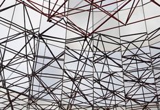 Roof of modern buildings. Image shows an abstract celling metal construction on blue sky background stock photography