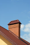 The roof of a modern house with brick chimney Stock Photos