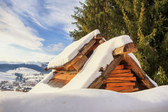 The roof of the mountain covered with snow house Stock Images
