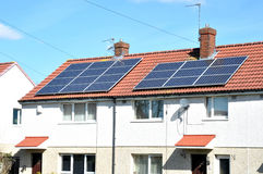 Roof Mounted Solar Panels. Domestic roof mounted solar panels on houses Stock Photo