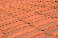 Roof from a natural classical tile. Classical natural orange tile on a roof Royalty Free Stock Image