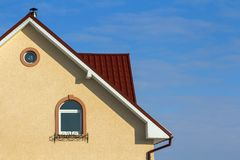 Roof of a new built house with nice window and chimney. Royalty Free Stock Images