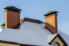 Roof of a new built house with nice window and chimney. Stock Photos