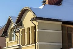 Roof of a new built house with nice window and chimney. Royalty Free Stock Image