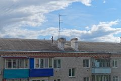 Roof of an old apartment house against amazing cloudy sky. Komsomolsk-on-Amure, Russia royalty free stock photos