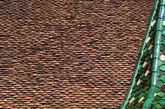 Roof of old building with turret covered with glazed tiles stock photo