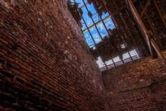 Through the roof. Old farm in Heythuysen Stock Image