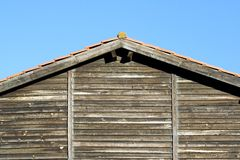 The roof of an old house. The roof of an old wooded house stock photos