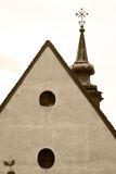 Roof of the old house and church spike. Royalty Free Stock Images