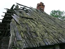 Roof of old house from a lath. Neglected rural made of logs house with a tumbledown roof Royalty Free Stock Image