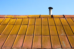 Roof with old metal tile Stock Photos