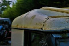 Roof Of Old Run Down Jeep Covered With Moss. A Shot Of An Abandoned Jeep With Dirty Roof Stock Photos