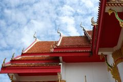 The roof of the old temple central Phuket. Beautiful blue eyes clear over the roof of the ancient temples in the canteen central Phuket downtown royalty free stock photos