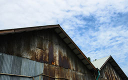 Roof. Old tin roof with a cloudy sky moderate Stock Photos