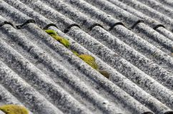 Roof. Old unhealthy fiber asbestos home roof Royalty Free Stock Photography