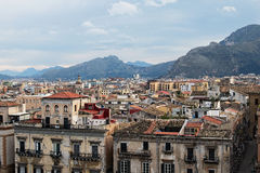 From the roof of Palermo Cathedral you can see amazing cityscape of Palermo. Beautiful tiled roofs of old houses. Nice mountain. Royalty Free Stock Photo