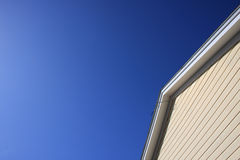 Roof peak with blue sky Stock Images