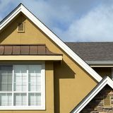 Roof Peaks. With stucco siding,rock and metal roof details Stock Image
