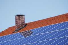 Roof with photovoltaic cells Stock Images
