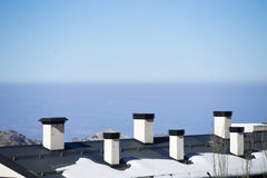 Roof pipe in ski resort. Royalty Free Stock Images