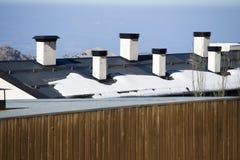 Roof pipe in ski resort. Royalty Free Stock Photos