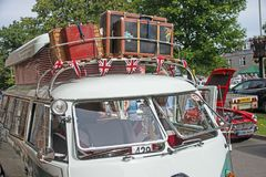 Roof rack luggage detail. Early VW Camper van showing popup roof and luggage on top with union Jack flags as decoration shown at Motor Mania Grantown on Spey on royalty free stock image