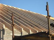 Roof Rafters. Joining ridge board in house construction stock image