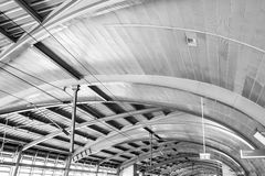 The roof of an railway station. The roof of the station of the Skytrain in Bangkok with electricity pylon Stock Images