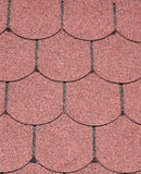 Roof with red bitumen shingles closeup Royalty Free Stock Image