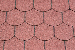 Roof with red bitumen shingles closeup Stock Photos