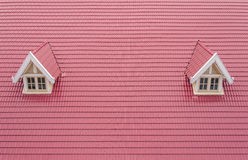 Roof with red tiles of house with white window Royalty Free Stock Image