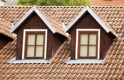 Dormer and a tiled roof. Roof with red tiling and two dormer windows Royalty Free Stock Image
