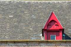 Roof and red window Royalty Free Stock Photo
