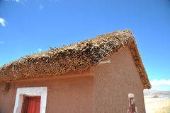 The roof of reeds in Bolivian mountain village in the vastness of the Altiplano. Royalty Free Stock Photo