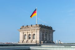 Roof of Reichstag Bundestag building with german flag. royalty free stock images