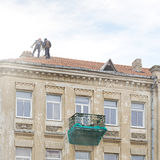Roof repair of old building Stock Image