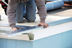 Roof repair. A worker repair roof royalty free stock image