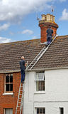 Roof repairs following storm Stock Photo