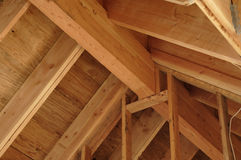 Roof ridge and rafters. Interior view of a pitched timber roof showing the ridge, rafters and sheathing royalty free stock photos