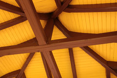 Roof ridge and rafters. Interior view of a pitched timber roof showing the ridge, rafters and sheathing stock photography