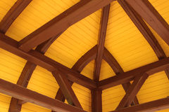Roof ridge and rafters. Interior view of a pitched timber roof showing the ridge, rafters and sheathing royalty free stock image