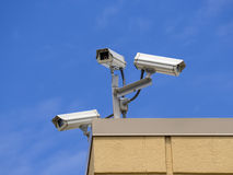 Roof  security cameras. Three outdoor roof  security cameras cover multiple angles Stock Image