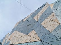 A roof shaped of sandstone on fed square. A detail of one of the buildings on Federation square in Melbourne in Victoria in Australia stock photography