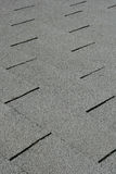 Roof shingle detail. Diagonal detail of gray roof shingles Stock Photography