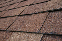 Roof shingle detail. Closeup detail of brown roof shingles Royalty Free Stock Photography