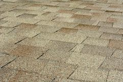 Roof shingles. Closeup on shingles after the rain Stock Images