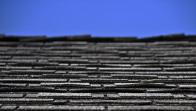 Roof shingles and blue sky Royalty Free Stock Photo