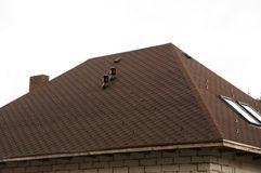 Roof Shingles - Roofing. Asphalt Roofing Shingles. Urban House Or Building. Bitumen Tile Roof. Unfinished Chimney System