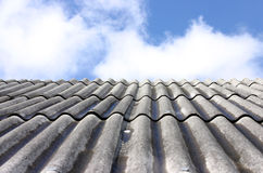 Roof and the sky. Abstract rooftop view and blue sky with clouds Royalty Free Stock Photos